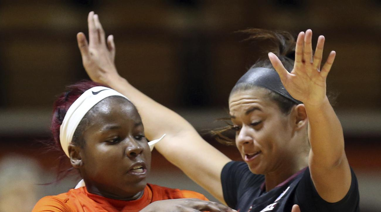 Alexis Peterson (1) of Syracuse collides with Virginia Tech defender Kendyl Brooks (10)in the second half of an NCAA college basketball game in Blacksburg, Va., Sunday, Jan. 29, 2017. Syracuse won the game 82-72. (Matt Gentry/The Roanoke Times via AP)