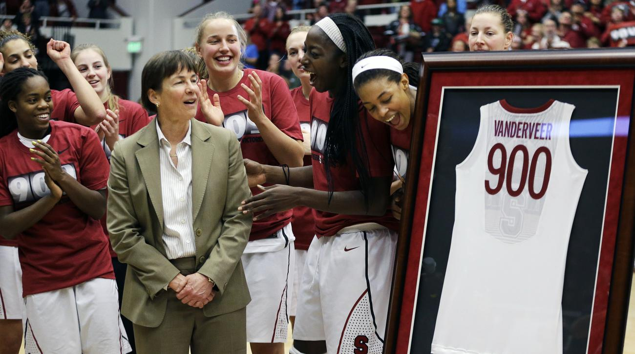 FILE - In this Dec. 14, 2013, file photo, Stanford coach Tara VanDerveer, second from left, is presented a framed jersey in recognition of her 900 career wins after the team's NCAA college basketball game against Gonzaga in Stanford, Calif. On Friday nigh