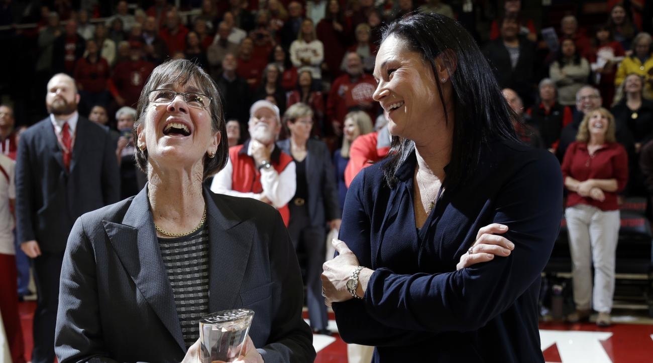 Stanford coach Tara VanDerveer, left, watches a video tribute with former player Jennifer Azzi after her 1,000th career win, in the team's NCAA college basketball game against Southern California on Friday, Feb. 3, 2017, in Stanford, Calif. (AP Photo/Marc