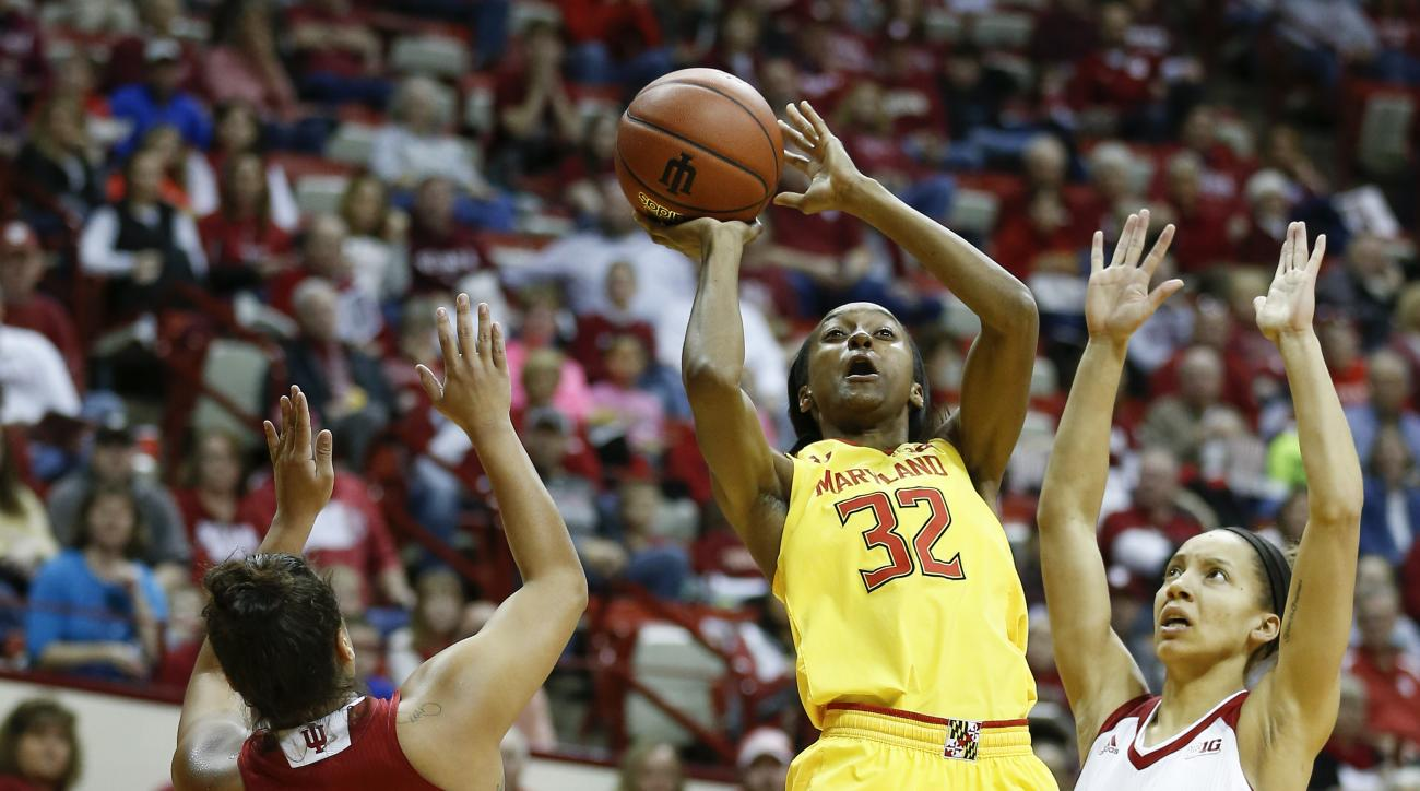 Maryland guard Shatori Walker-Kimbrough (32) shoots between Indiana guard Karlee McBride (21) and Indiana guard Alexis Gassion (23) during the first half of an NCAA college basketball game Sunday, Feb. 5, 2017, in Bloomington, Ind. (AP Photo/Sam Riche)
