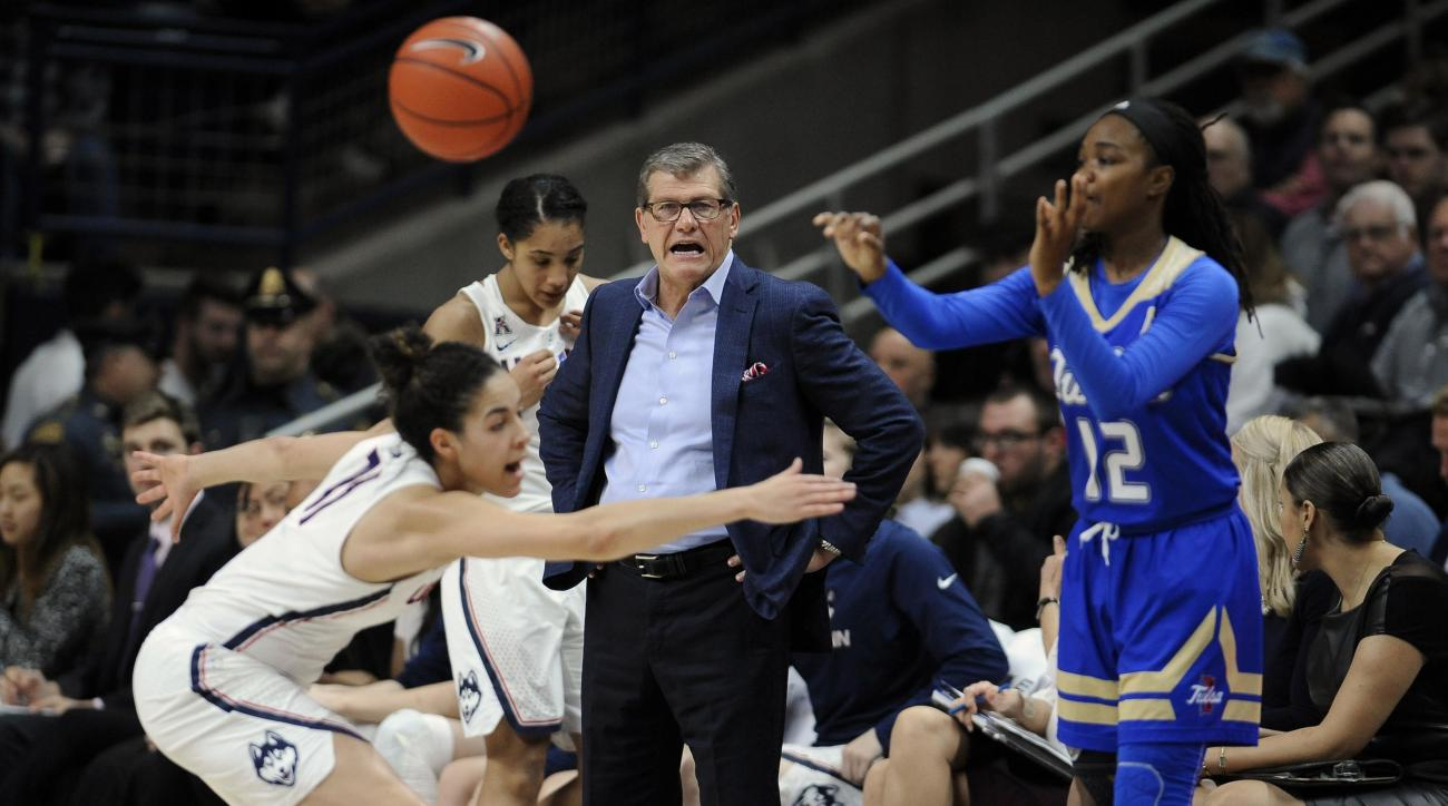 Connecticut head coach Geno Auriemma, center, calls to Connecticut's Kia Nurse, left, as Tulsa's Shug Dickson inbounds the ball in the half of an NCAA college basketball game, Sunday, Feb. 5, 2017, in Storrs, Conn. (AP Photo/Jessica Hill)