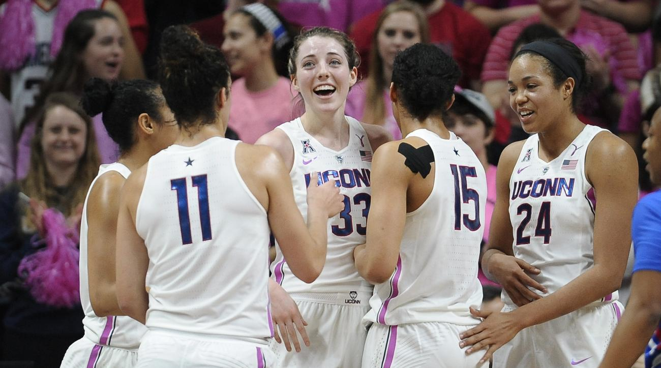 Connecticut's Katie Lou Samuelson, center, smiles after she is fouled and picked up by her teammates in the first half of an NCAA college basketball game against SMU, Saturday, Feb. 11, 2017, in Storrs, Conn. (AP Photo/Jessica Hill)