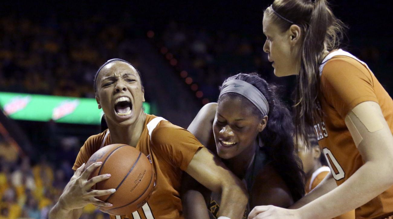 FILE - In this Feb. 6, 2017, file photo, Texas guard Brianna Taylor (20) grabs a rebound against Baylor forward Kalani Brown, center, during the first half of an NCAA college basketball game in Waco, Texas. Looking on is Texas center Kelsey Lang, right. W