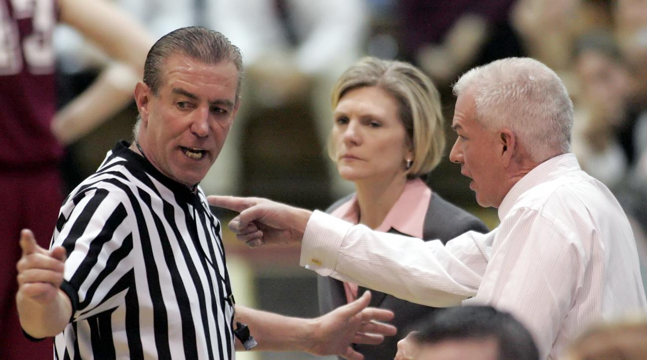 FILE - In a March 5, 2006, file photo, Saint Joseph's coach Cindy Griffin, center, watches as George Washington coach Joe McKeown, right, and referee Dennis DeMayo discuss a shot-clock violation late in the second half of an Atlantic 10 basketball champio