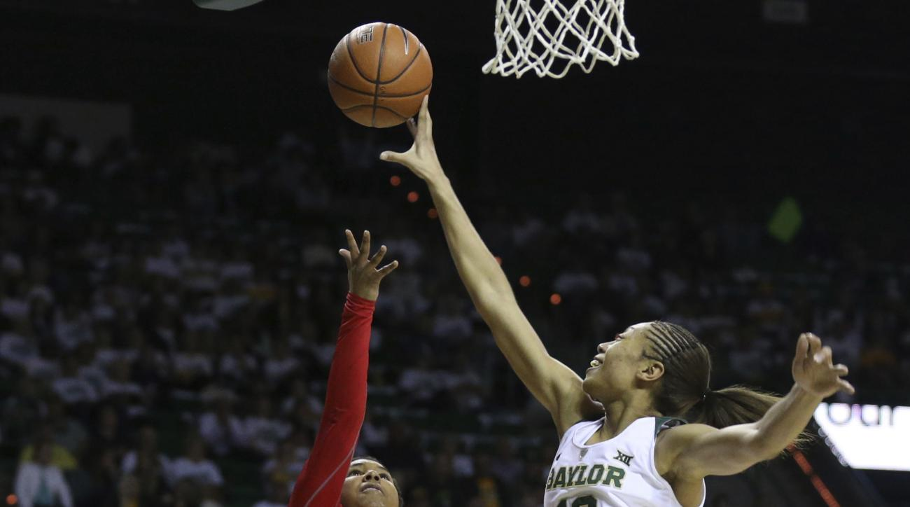 Baylor guard Alexis Prince, right, blocks the shot of Texas Tech guard Larryn Brooks, left, in the first half of an NCAA college basketball game, Saturday, Feb. 25, 2017, in Waco, Texas. (AP Photo/Rod Aydelotte)