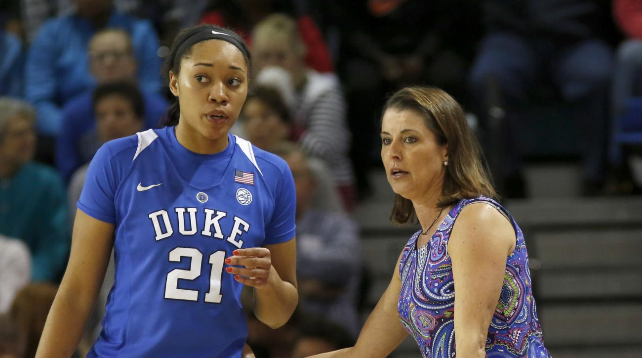Duke's head coach Joanne P. McCallie talks with player Kendall Cooper during their game against Notre Dame during the first half of an NCAA college championship basketball game in the Atlantic Coast Conference tournament at the HTC Center in Conway, S.C.,