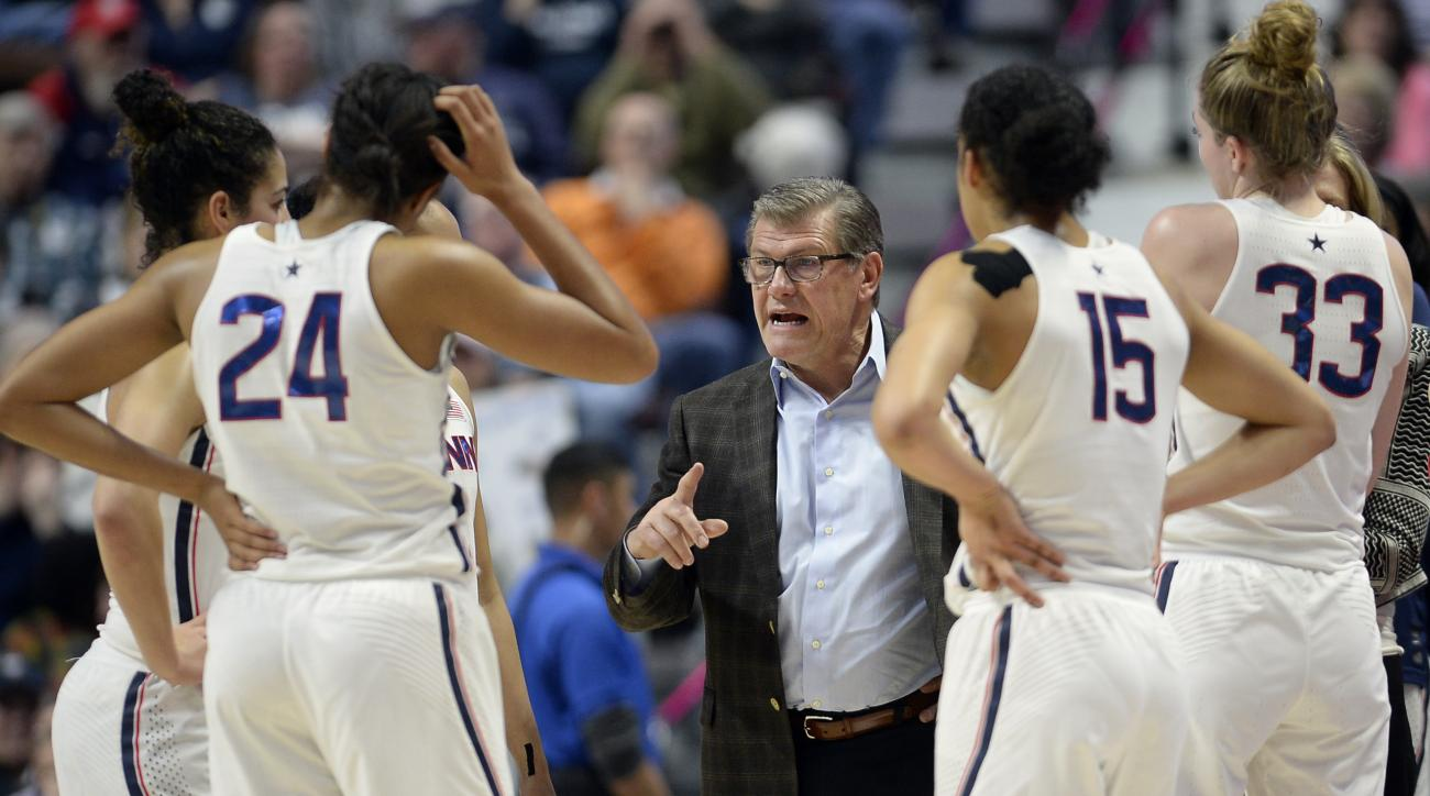 Connecticut head coach Geno Auriemma, center, talks to his team during a timeout during the first half of an NCAA college basketball game against Central Florid in the American Athletic Conference tournament semifinals at Mohegan Sun Arena, Sunday, March