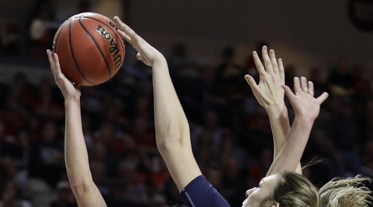 Gonzaga's Elle Tinkle, left, shoots over Saint Mary's Sydney Raggio in the first half of an NCAA college basketball game in the championship of the West Coast Conference tournament, Tuesday, March 7, 2017, in Las Vegas. (AP Photo/John Locher)