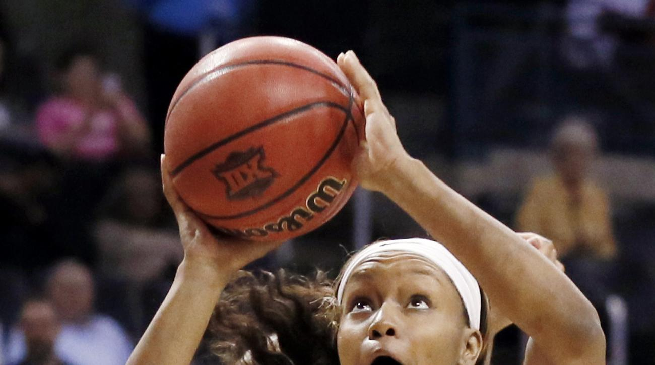 FILE - In this Monday, March 6, 2017, file photo, Baylor forward Nina Davis (13) shoots in the first half of an NCAA college basketball game against  West Virginia at the Big 12 Conference tournament championship in Oklahoma City. Davis is a two-time AP A