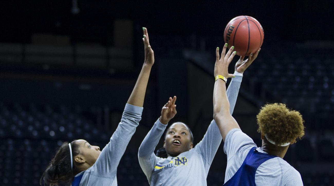 Notre Dame's Lindsay Allen (15) puts up a shot past Diamond Thompson (35) and Brianna Turner (11) during a practice at Purcell Pavilion in South Bend, Ind. Thursday, March 16, 2017 in advance of the first round of the NCAA Division 1 Women's Basketball To