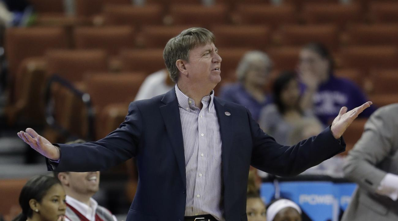 North Carolina State head coach Wes Moore questions a call during a first-round game against Auburn in the NCAA women's college basketball tournament, Friday, March 17, 2017, in Austin, Texas. North Carolina State won 62-48. (AP Photo/Eric Gay)