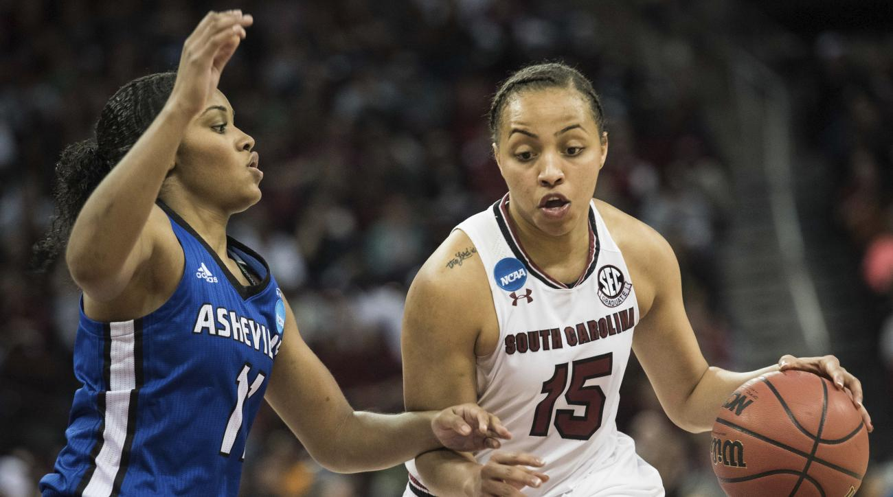 South Carolina guard Tiffany Davis (15) dribbles around North Carolina Asheville guard Khaila Webb (11) during a first-round game in the women's NCAA college basketball tournament Friday, March 17, 2017, in Columbia, S.C. South Carolina defeated UNC Ashev