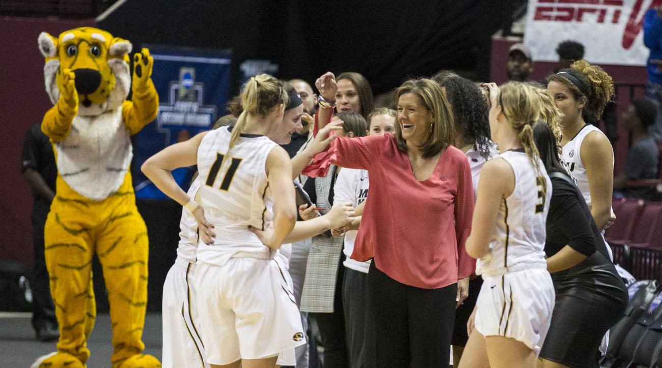 Missouri head coach Robin Pingeton, center, celebrates their last second winning basket to defeat South Florida 66-64 during a first-round game in the women's NCAA college basketball tournament in Tallahassee, Fla., Friday March 17, 2017. (AP Photo/Mark W