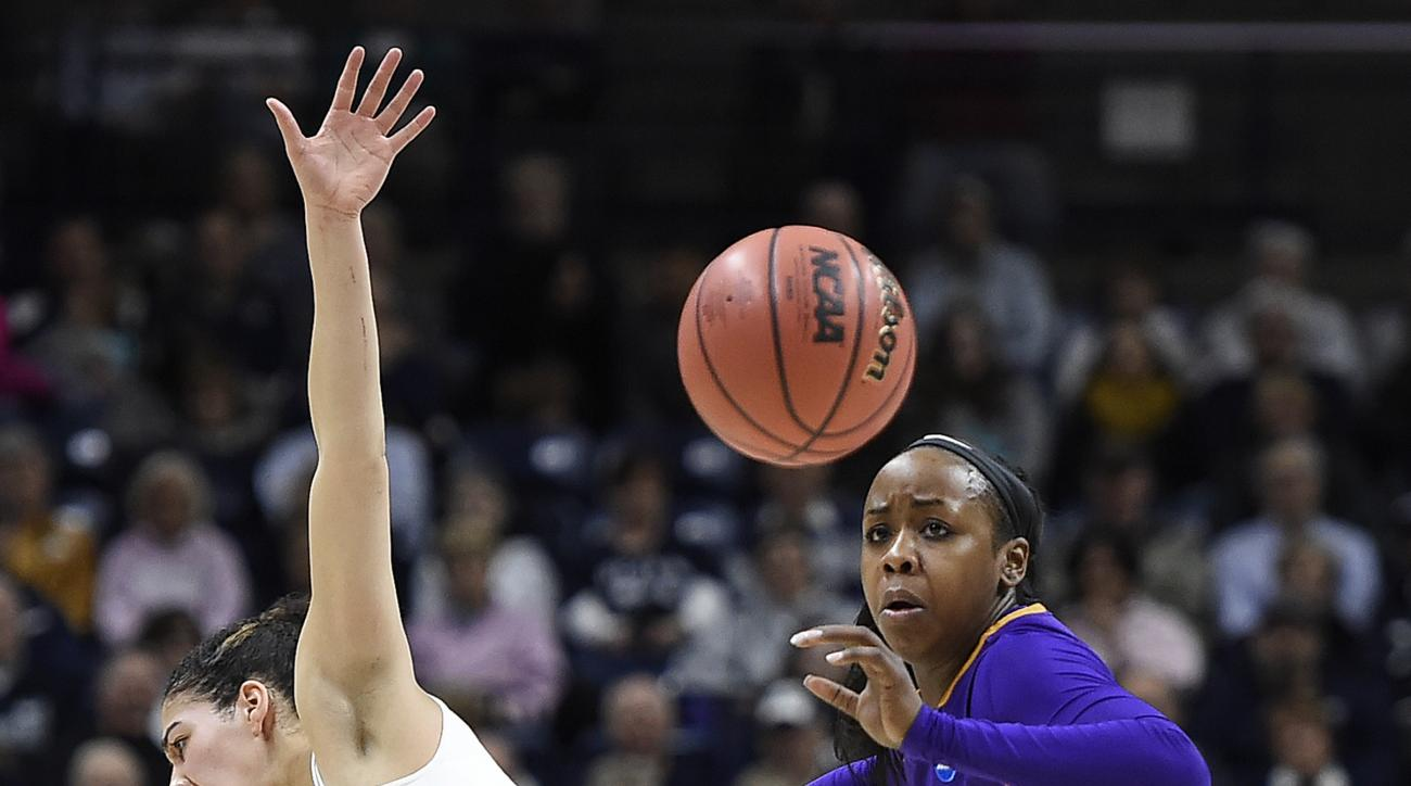 Connecticut's Kia Nurse, left, is pushed away by Albany's Imani Tate as they chase down a loose ball during the first half of a first round round of a women's college basketball game in the NCAA Tournament, Saturday, March 18, 2017, in Storrs, Conn. (AP P