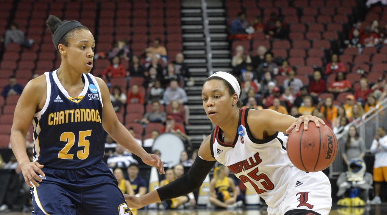 Louisville's Asia Durr (25) attempts to drive around the defense of Chattanooga's Chelsey Shumpert (25) in the second half of a first-round game in the women's NCAA college basketball tournament, Saturday, March 18, 2017, in Louisville, Ky. Louisville won