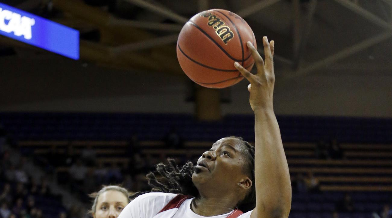 Oklahoma's Vionise Pierre-Louis gets off a shot as she tumbles after being bumped against Gonzaga during the first half of a first-round game in the NCAA women's college basketball tournament Saturday, March 18, 2017, in Seattle. (AP Photo/Elaine Thompson