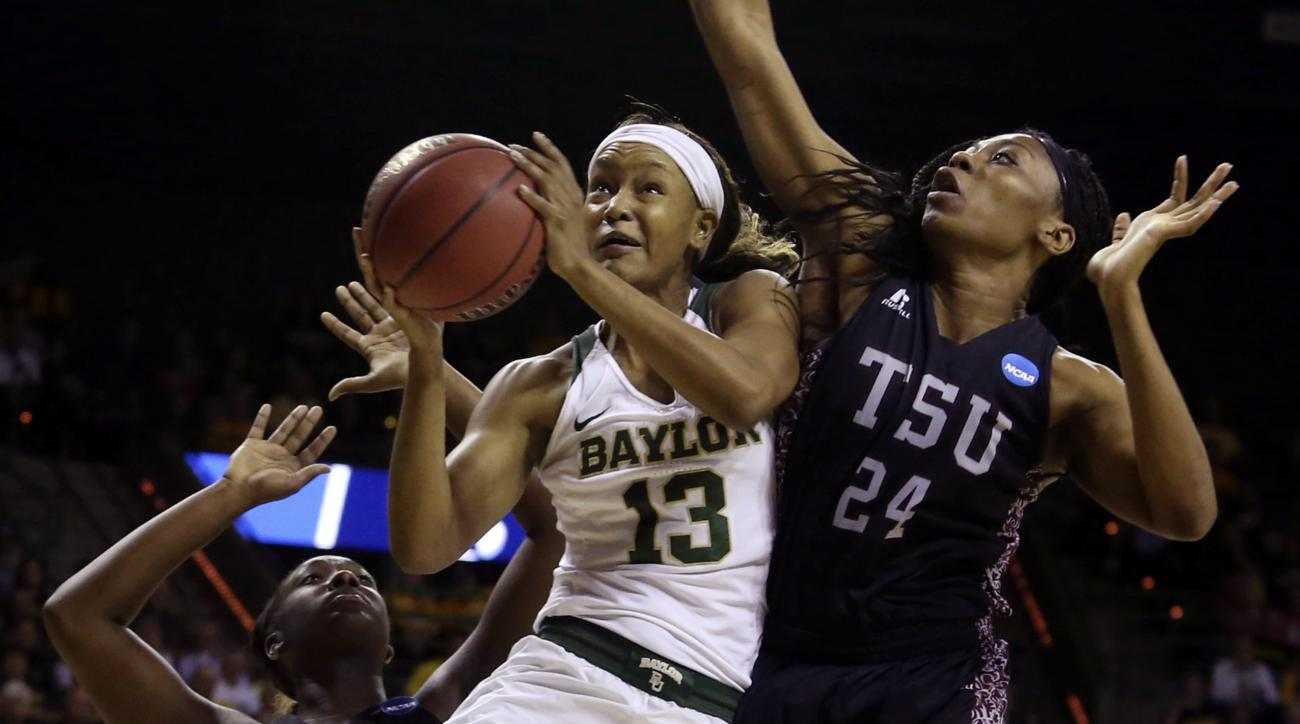 Baylor forward Nina Davis (13) drives between Texas Southern center Artavia Ford (24) and forward Breasia McElrath (22) in the first half of a first-round game in the women's NCAA college basketball tournament, Saturday, March 18, 2017, in Waco, Texas. (A