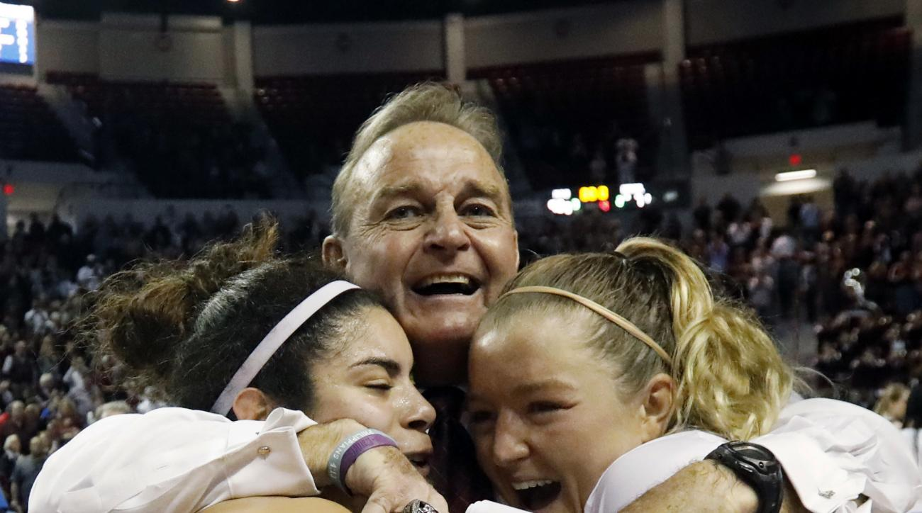 Mississippi State guard Dominique Dillingham, left, and teammate Blair Schaefer are hugged by their coach Vic Schaefer following their second-round win over DePaul, 92-71, in the women's NCAA college basketball tournament in Starkville, Miss., Sunday, Mar