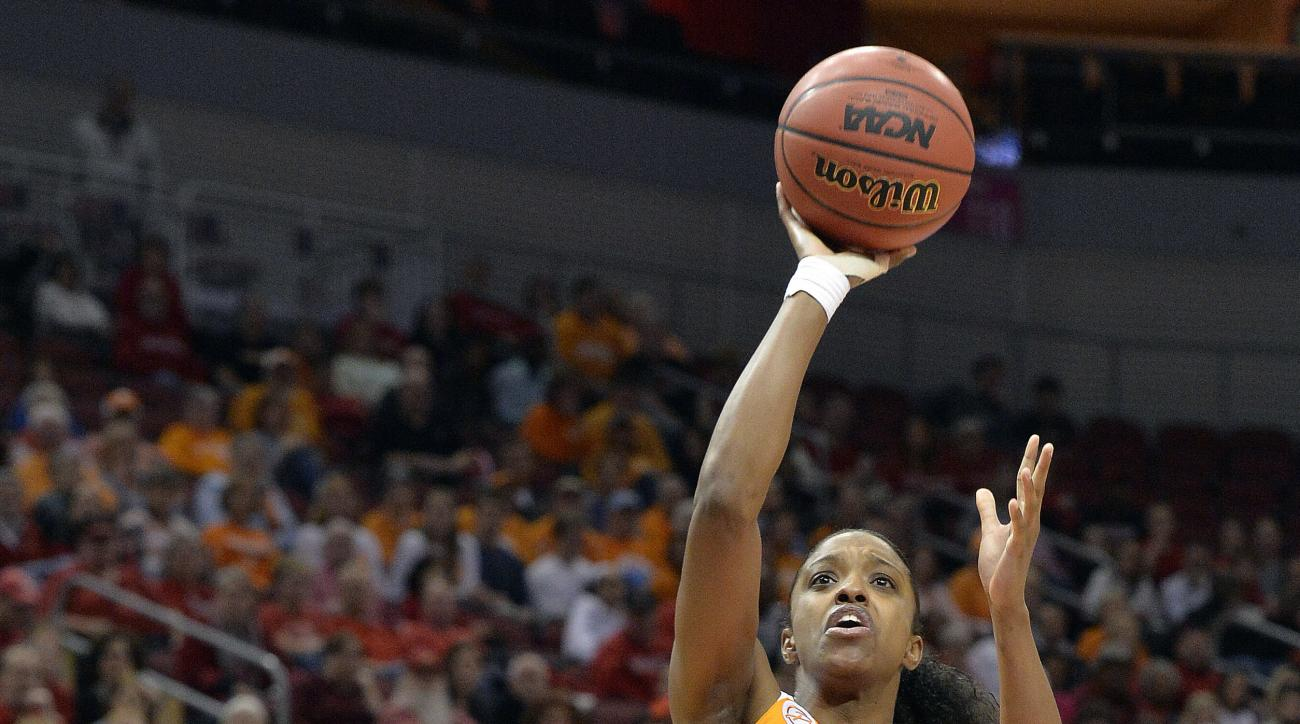 Tennessee's Diamond DeShields (11) charges into Louisville's Myisha Hines-Allen (2) during the first half of a second-round game in the NCAA women's college basketball tournament, Monday, March. 20, 2017, in Louisville, Ky. (AP Photo/Timothy D. Easley)