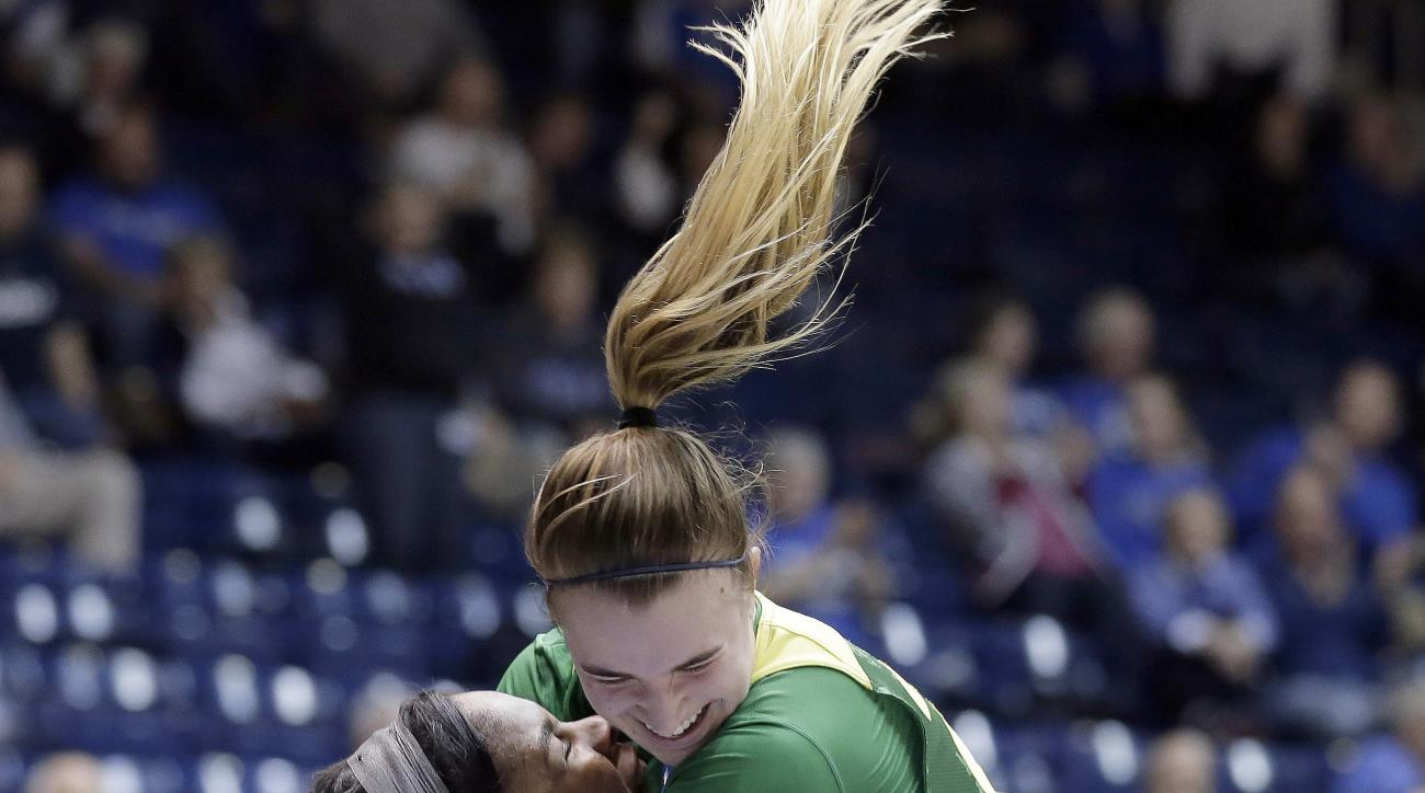 FILE - In this March 18, 2017, file photo, Oregon's Sabrina Ionescu, right, jumps into the arms of teammate Ruthy Hebard following Hebard's late shot to put Oregon ahead in the second half of a first-round game against Temple in the NCAA women's college b