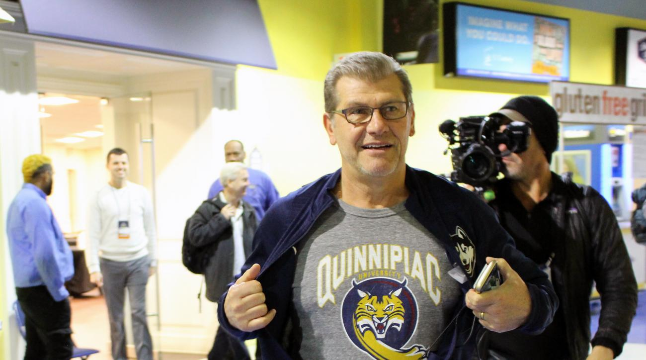 UConn coach Geno Auriemma displays a Quinnipiac University T-shirt before his team's Sweet 16 NCAA women's college basketball practice in Bridgeport, Ct., Friday, March 24, 2017. This is the first year both Connecticut schools have made it as far as the N