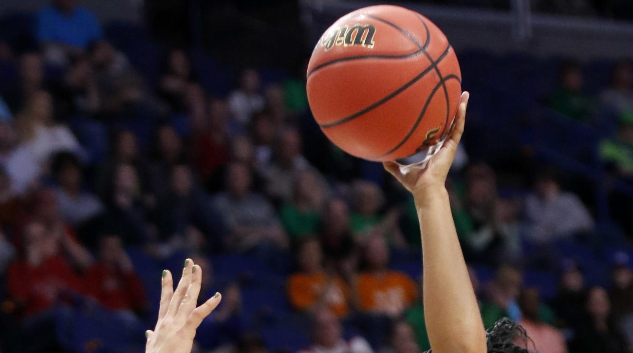 Ohio State's Kelsey Mitchell (3) shoots near Notre Dame's Arike Ogunbowale during a regional semifinal in the women's NCAA college basketball tournament in Lexington, Ky., Friday, March 24, 2017. (AP Photo/James Crisp)