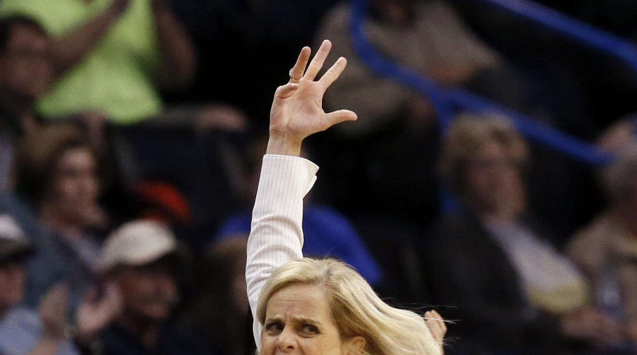 Baylor head coach Kim Mulkey motivates fans during the second half of a regional semifinal against Louisville in the NCAA women's college basketball tournament, Friday, March 24, 2017, in Oklahoma City. (AP Photo/Sue Ogrocki)