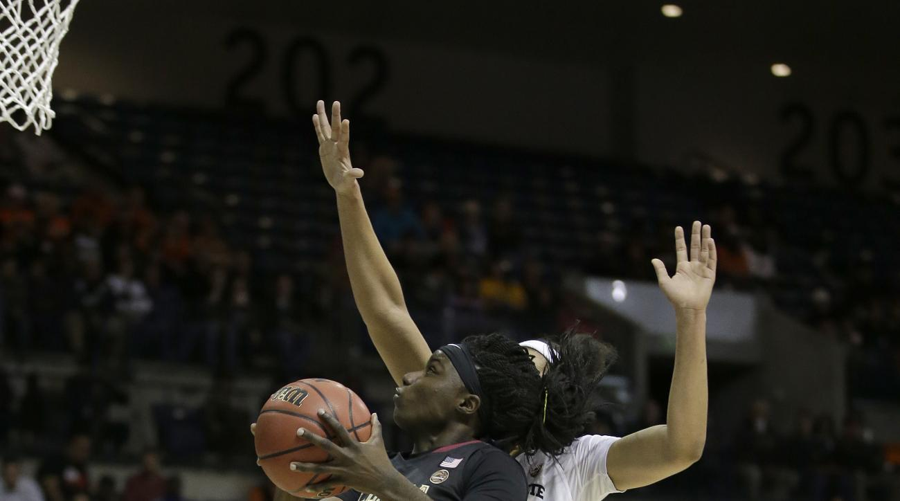 Florida State forward Shakayla Thomas, left, goes to the basket against Oregon State center Breanna Brown during the first half of a regional semi-final round game of an NCAA college basketball tournament, Saturday, March 25, 2017, in Stockton, Calif. (AP