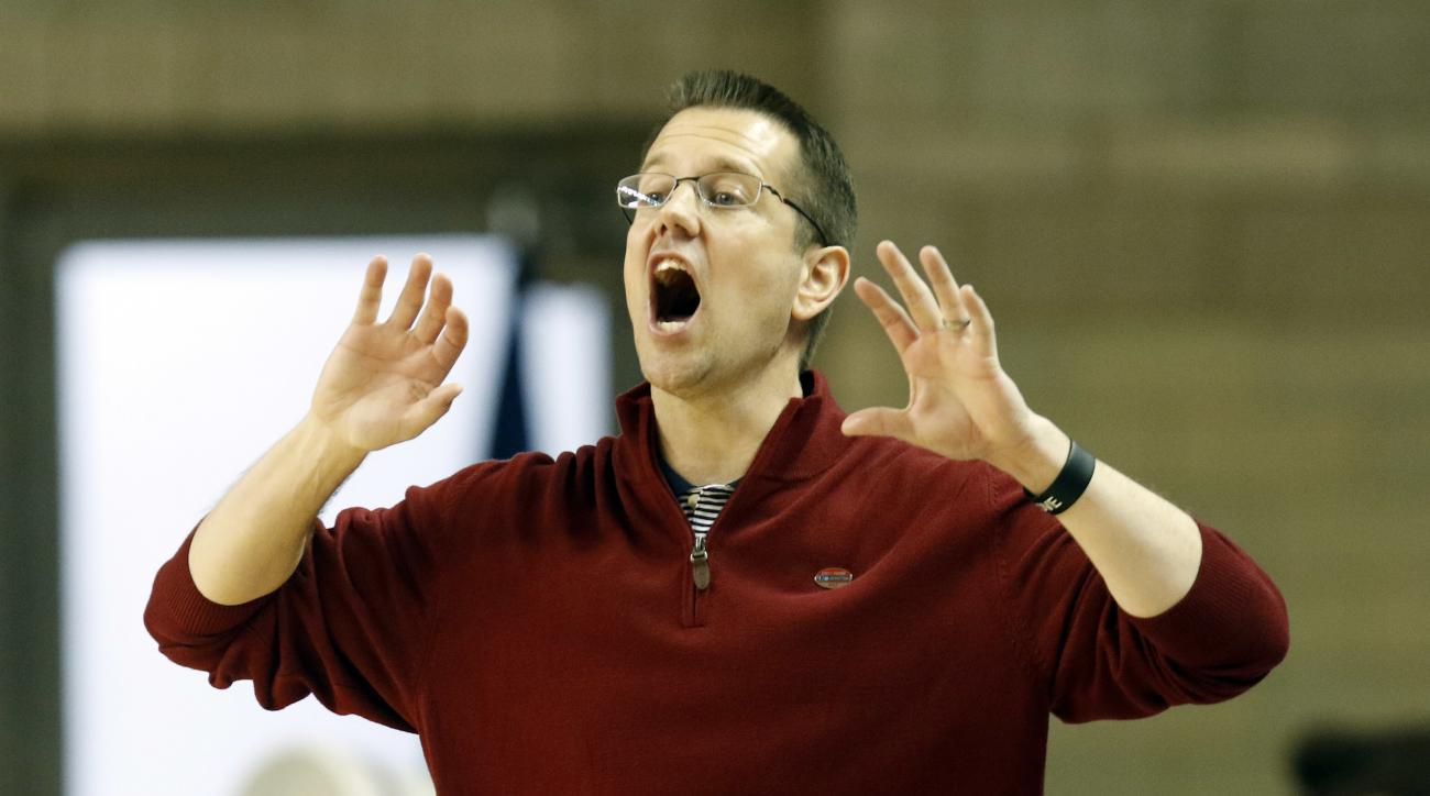 FILE- This March 17, 2017 file photo shows Belmont head coach Cameron Newbauer yelling to his team during a first-round game in the women's NCAA college basketball tournament against Kentucky in Lexington, Ky. Florida hired Newbauer on Monday, March 27, 2