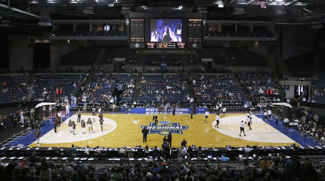 In this Monday, March 27, 2017 photo, South Carolina, left, Florida State warm up before their regional final game in the women's NCAA college basketball tournament at the Stockton Arena, in Stockton, Calif. Women's basketball saw its lowest attendance fo
