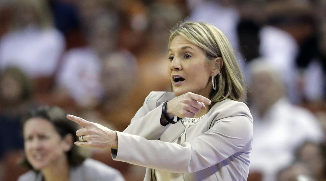 FILE - In this March 19, 2017, file photo, Texas coach Karen Aston directs her players during a second-round game against North Carolina State in the NCAA women's college basketball tournament in Austin, Texas. Texas played all four teams in the Final Fou