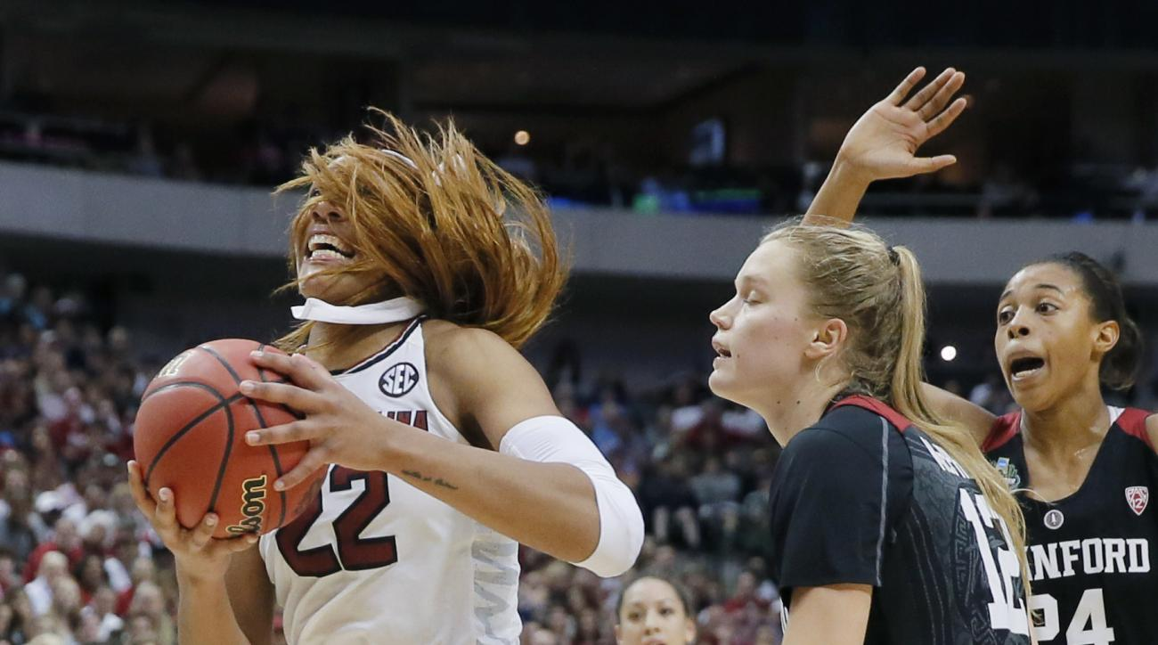 South Carolina forward A'ja Wilson (22) drives past Stanford guard Brittany McPhee (12) during the second half of an NCAA college basketball game in the semifinals of the women's Final Four, Friday, March 31, 2017, in Dallas.(AP Photo/Tony Gutierrez)