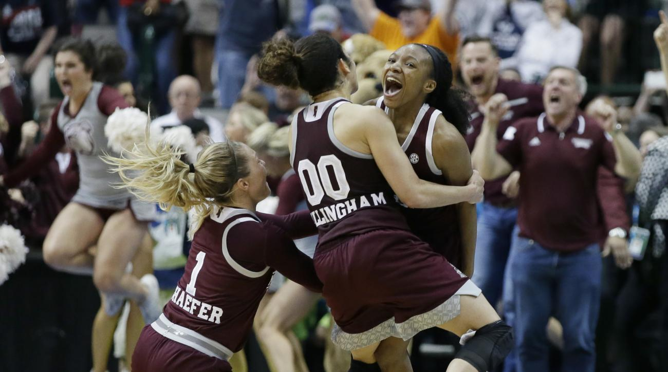 Mississippi State guard Morgan William, right, celebrates with teammates after she hit the winning shot against Connecticut in an NCAA college basketball game in the semifinals of the women's Final Four, Saturday, April 1, 2017, in Dallas. Mississippi Sta
