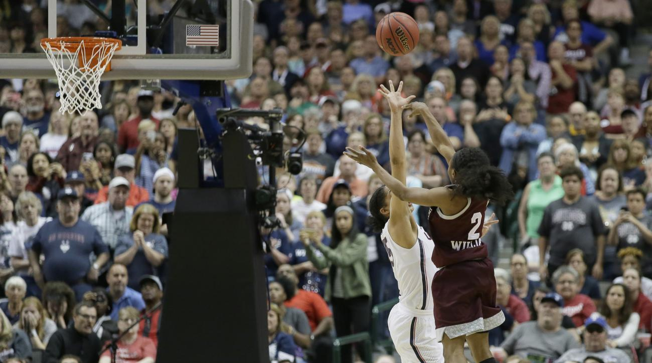Mississippi State guard Morgan William (2) shoots over Connecticut guard Gabby Williams (15) for the winning shot in an NCAA college basketball game in the semifinals of the women's Final Four, Friday, March 31, 2017, in Dallas. Mississippi State won 66-6