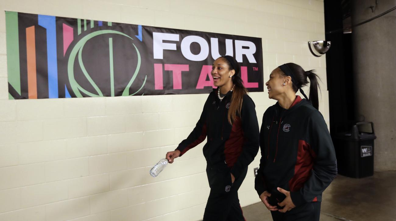 South Carolina forward A'ja Wilson, left, and South Carolina guard Allisha Gray, right, walk to their locker room following  a news conference at the women's Final Four college basketball tournament, Saturday, April 1, 2017, in Dallas. South Carolina will