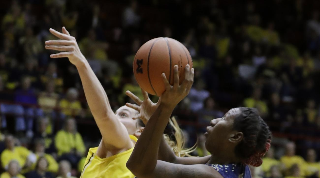 Georgia Tech forward Zaire O'Neil (21) shoots over the defense of Michigan center Hallie Thome (30) during the first half of the WNIT Championship college basketball game, Saturday, April 1, 2017, in Detroit. (AP Photo/Carlos Osorio)