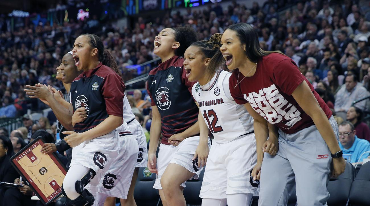 Members of the South Carolina bench cheer during the first half against Mississippi State in the final of NCAA women's Final Four college basketball tournament, Sunday, April 2, 2017, in Dallas. (AP Photo/Tony Gutierrez)