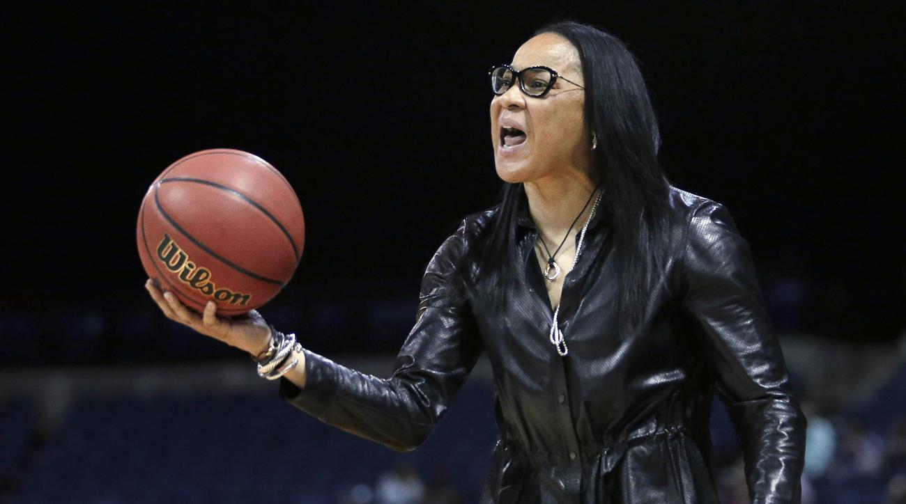 FILE - In this March 27, 2017, file photo, South Carolina head coach Dawn Staley protest a foul during the second half of a regional final  against Florida State in the NCAA college basketball tournament in Stockton, Calif. The annual report card from The