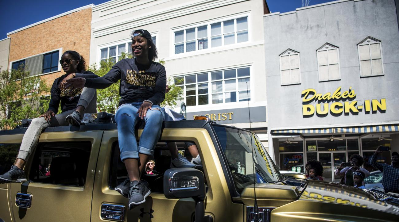 South Carolina guard Kaela Davis, left, and Doniyah Cliney celebrate with fans during the South Carolina women's basketball National Championship parade, Sunday, April 9, 2017, in Columbia, S.C. South Carolina defeated Mississippi State last Sunday to cap