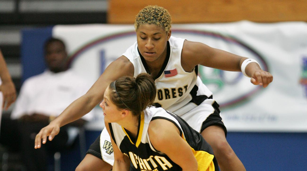 Wake Forest's Alex Tchangoue, top, covers Wichita State's Jacie Hoyt as she looks to pass from one knee, during a game in the Paradise Jam women's basketball competition, in Charlotte Amalie, U.S. Virgin Islands, Saturday, Nov. 24, 2007. Wake Forest won 5