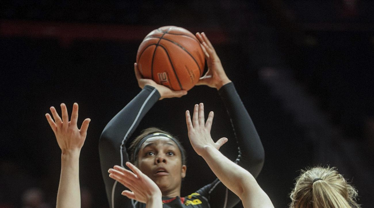 Maryland forward Kiah Gillespie (15) prepares to shoot over Illinois guard Ashley McConnell (12) and forward Sarah Overcash (20) in the second half during an NCAA college basketball game in Champaign, Ill., on Thursday, Jan. 26, 2017. Maryland won 94-49.