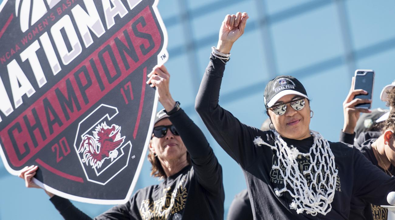 CORRECTS OPPONENT TO MISSISSIPPI STATE, INSTEAD OF MISSISSIPPI - South Carolina head coach Dawn Staley, right, and associate coach Lisa Boyer celebrate with fans during the South Carolina women's basketball National Championship parade, Sunday, April 9, 2