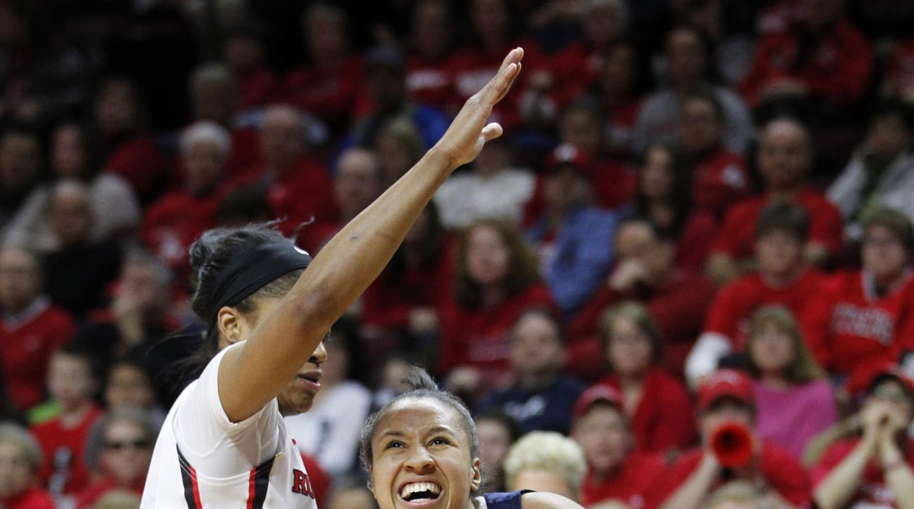 Penn State guard Lindsey Spann (12) charges the basket as Rutgers guard Briyona Canty (4) defends during the first half of an NCAA college basketball game in Piscataway, N.J., Sunday, Feb. 1, 2015. Rutgers defeated Penn State 76-65. (AP Photo/Rich Schultz
