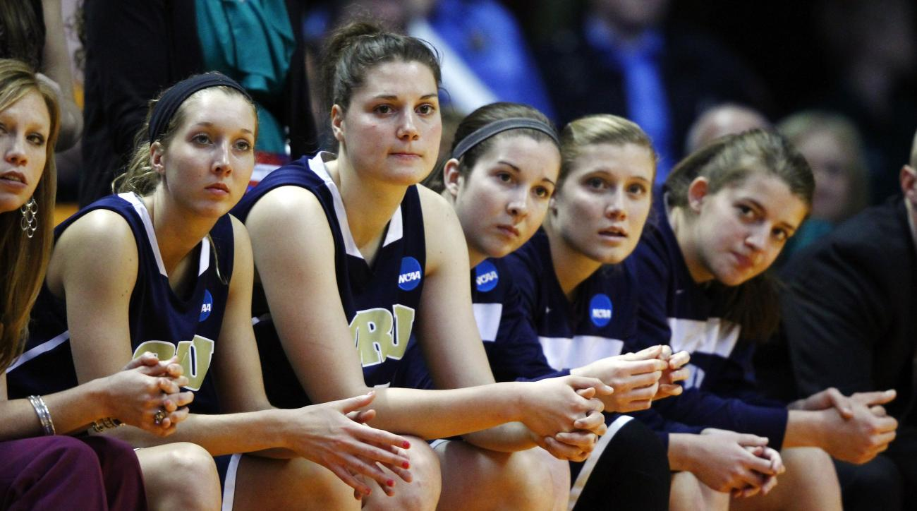 Oral Roberts players watch from the bench during the final minutes of a first-round game in the women's NCAA college basketball tournament against Tennessee, Saturday, March 23, 2013, in Knoxville, Tenn. Tennessee won 83-62. (AP Photo/Wade Payne)
