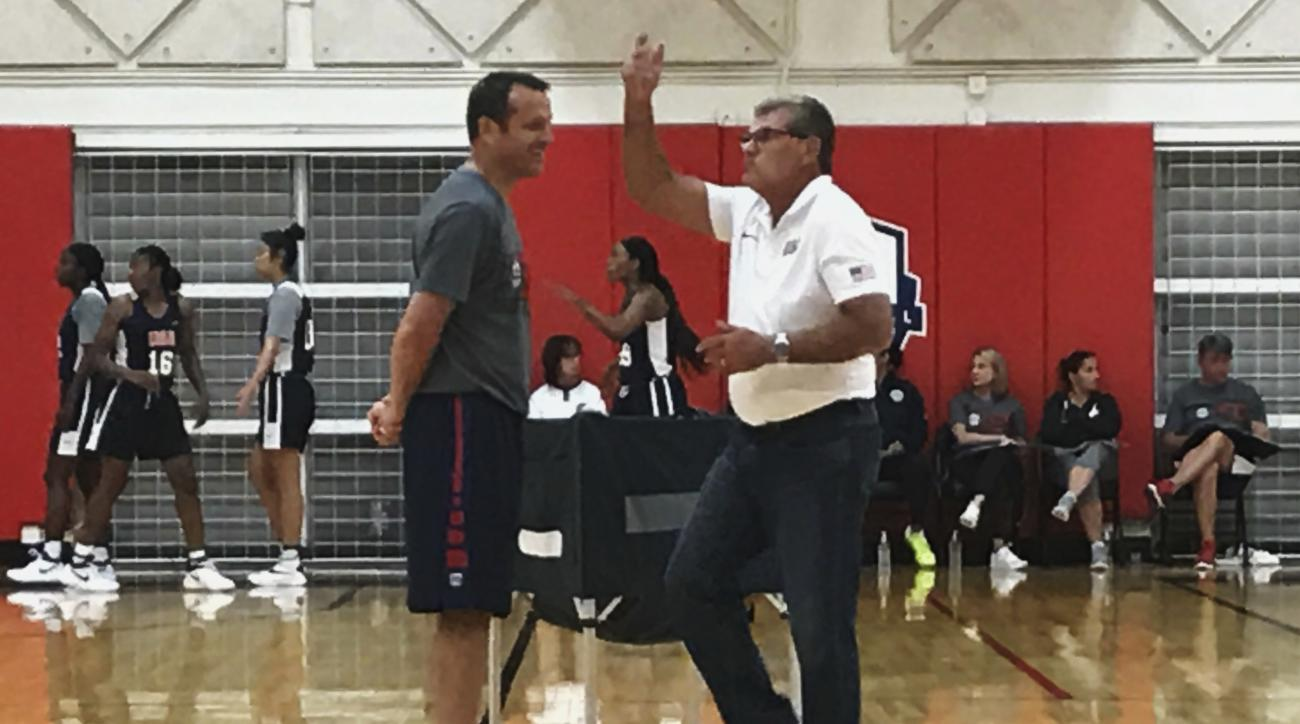 Connecticut head coach Geno Auriemma, right, and Louisville head coach Jeff Walz talk during an Under-23 training camp in Colorado Springs, Colo., Monday, July 31, 2017. Walz is the head coach of the team. With the start of the college basketball season t