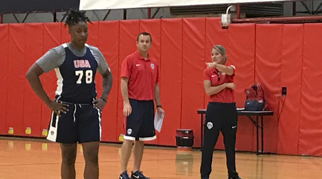 Southern California forward Kristen Simon pauses as coaches Jeff Walz and Courtney Banghart watch, during the second day of th einaurual Under-23 USA Basketball training camp, Tuesday, Aug. 1, 2017, in Colorado Springs, Colo. (AP Photo/Doug Feinberg)