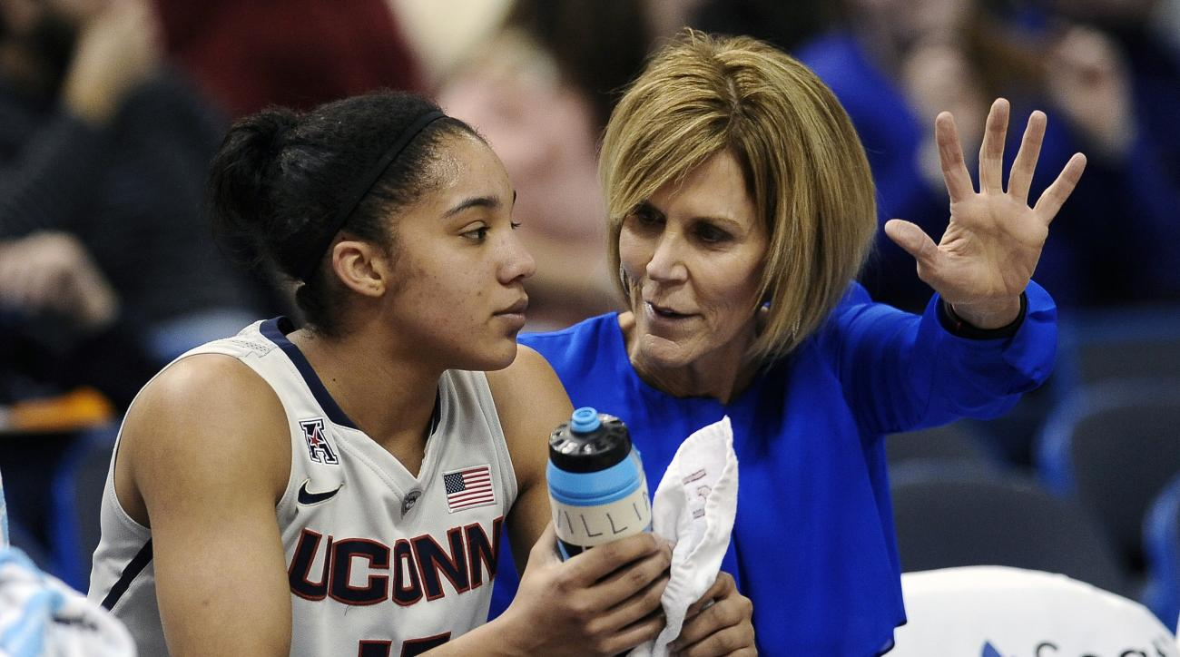 FILE - In this Jan. 28, 2015, file photo, Connecticut associate head coach Chris Dailey, right, talks with Gabby Williams, left, during the first half of an NCAA college basketball game in Hartford, Conn. Dailey will be honored by the Connecticut Sun on T