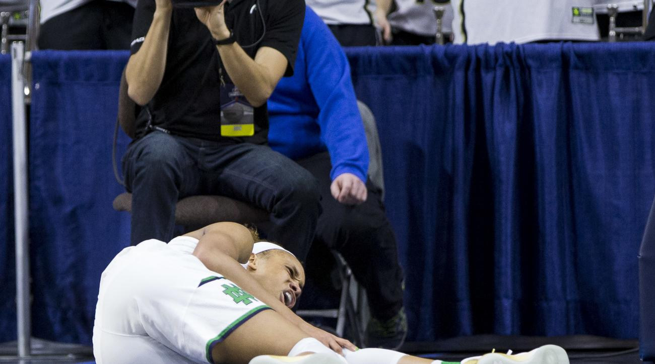 FILE - In this Sunday, March 19, 2017, file photo, Notre Dame's Brianna Turner reacts to a knee injury during the first half of a second-round game against Purdue in the NCAA college basketball tournament in South Bend, Ind. Top-seeded Notre Dame tries to