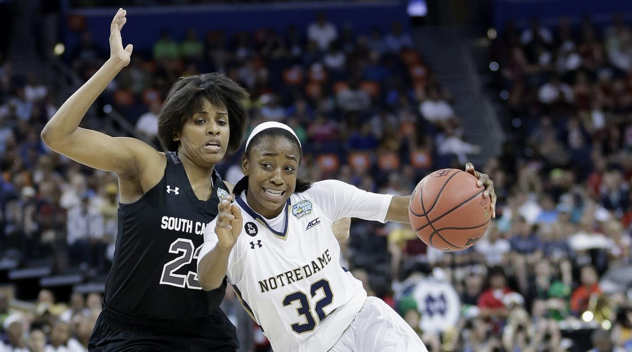 FILE - In this April 5, 2015, file photo, Notre Dame guard Jewell Loyd (32) moves by South Carolina guard Tina Roy (23) during the first half of the NCAA Women's Final Four tournament college basketball semifinal game in Tampa, Fla. Seattle coach Jenny Bo