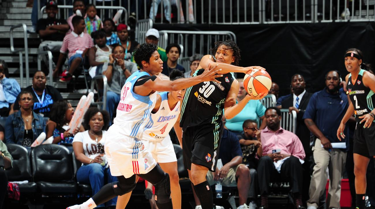 ATLANTA, GA - JUNE 21: Tanisha Wright #30 of the New York Liberty handles the ball Angel McCoughtry #35 of the Atlanta Dream at Philips Center on June 21, 2015 in Atlanta, GA. (Photo by Scott Cunningham/NBAE via Getty Images)